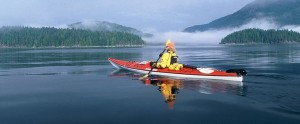 sea kayaker padding through BC discovery islands