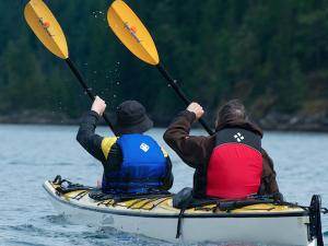 tandem ocean kayakers in lifejackets